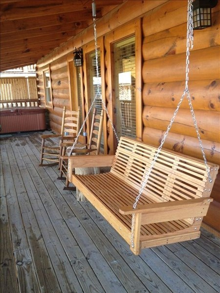 Swing, rockers and hot tub on back covered porch