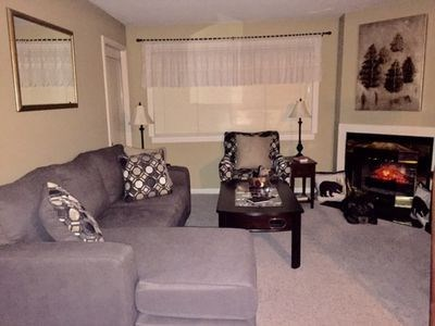 Relax with your family enjoying the views, games, & electric fireplace!
