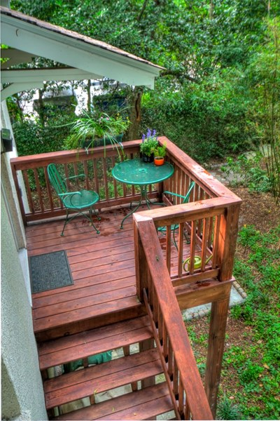 Enjoy a morning cup of coffee or an afternoon lunch on your private deck overlooking the garden!