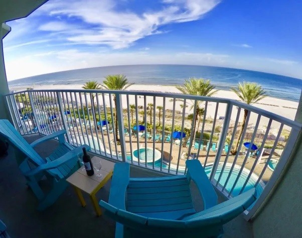 4th floor Balcony overlooking center of pool and 180 degree view of gulf