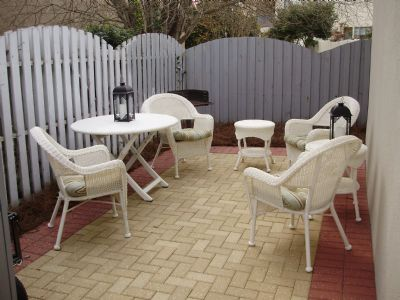 Great brick patio with new wicker furnishings, grill and wagon to take to the beach