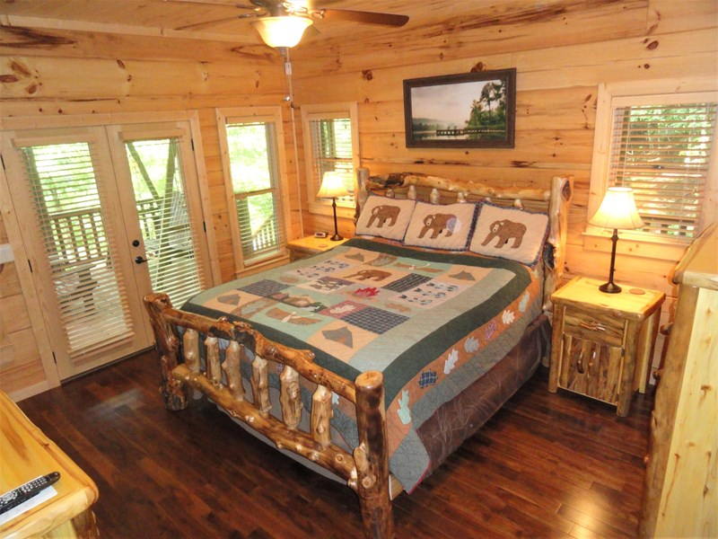 Main level - Master with king bed and lake views through French doors to deck
