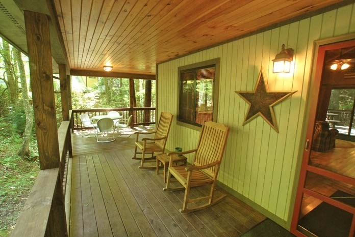 L-shaped front porch with rocking chairs