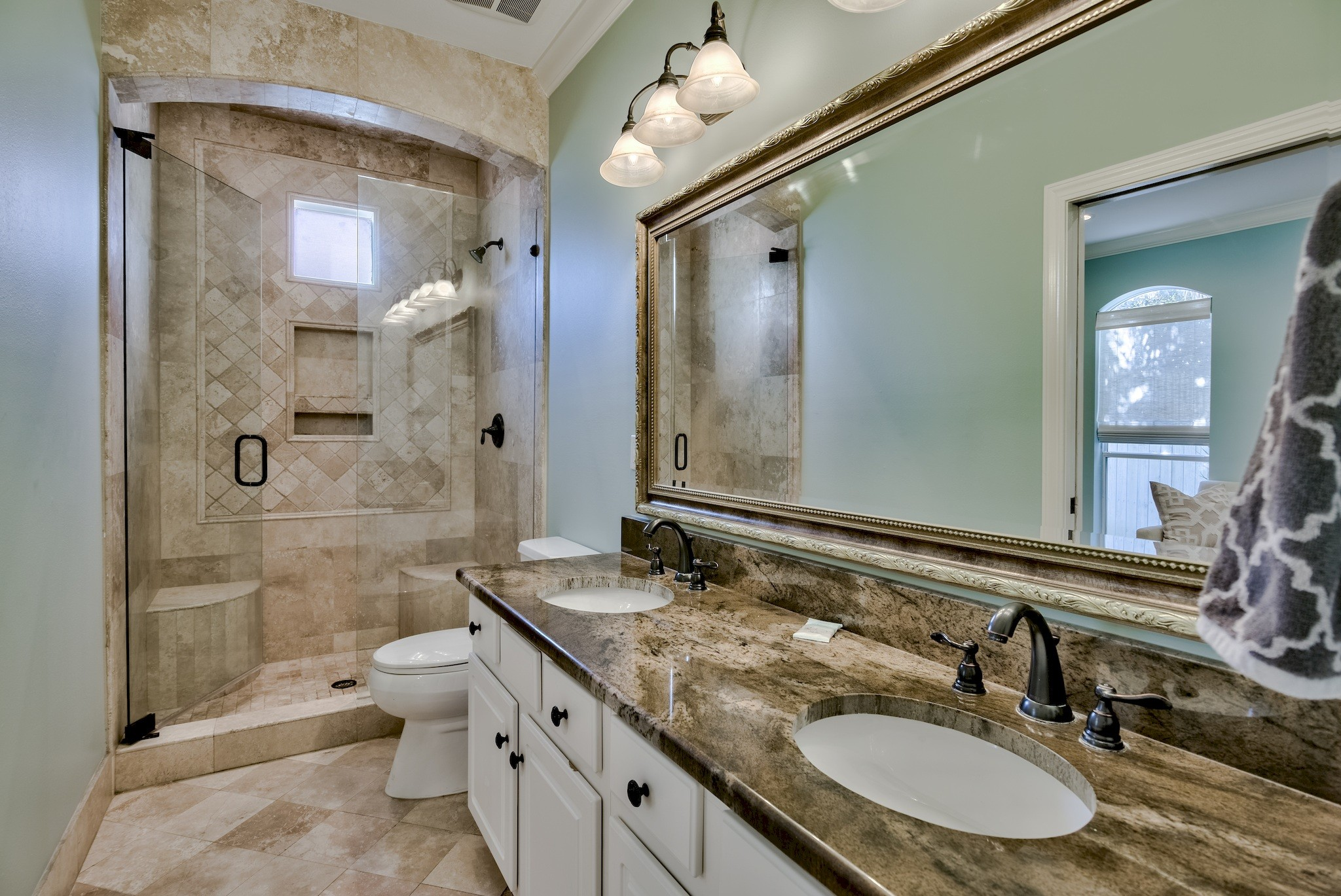 Master Bath 1:  Travertine stone, twin vanities and exotic granite counters throughout!