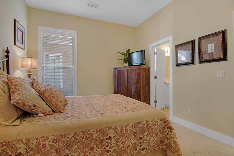 Downstairs bedroom has access to bath and features a queen bed plus 32 in flat screen tv