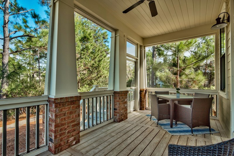 Screened porch with Lake Views and table with chairs and separate seating area