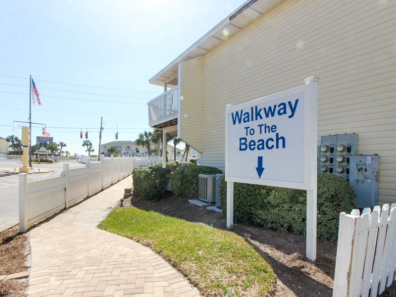 Short walk to beach or private parking if you want to drive