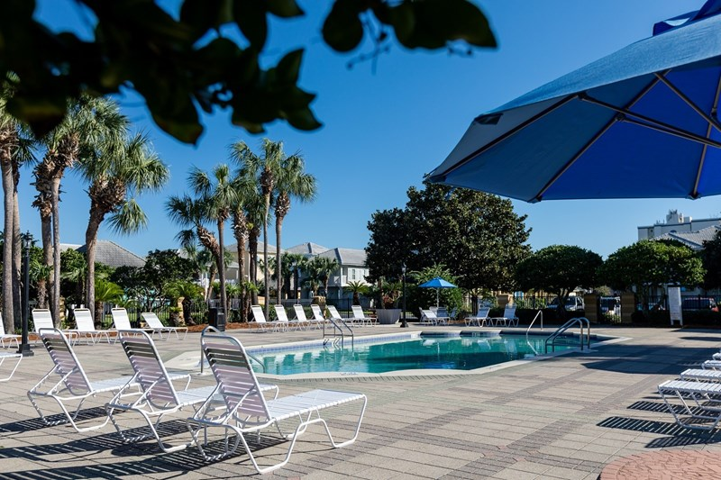 Main pool with large sundeck, tables with umbrellas and new furniture in 2018