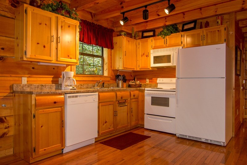 Kitchen is fully stocked with everything you need to cook meals at the cabin.