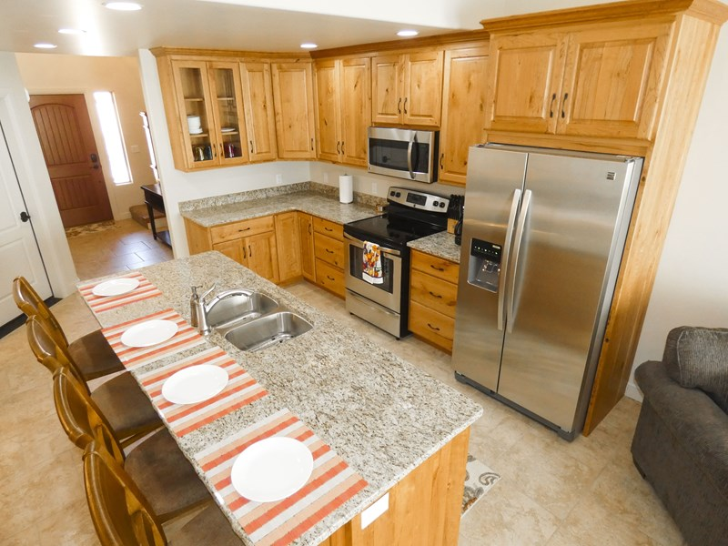 Kitchen Includes Coffee Maker, Refrigerator, Dishwasher, Microwave, Stove, & Oven.