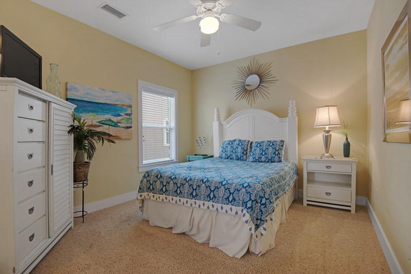 guest bedroom features a queen bed with access to bath plus flat screen tv