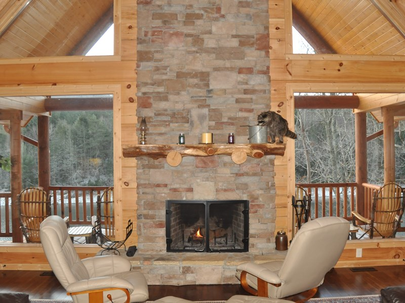 Main level - Living room with 25' stacked stone fireplace to snuggle up next to