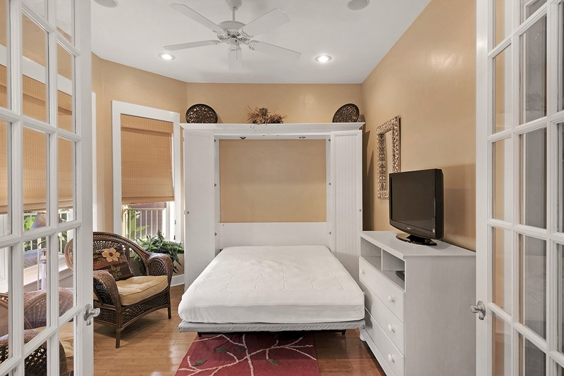 Bedroom on the first floor has a queen size murphy bed & lg flat screen tv.