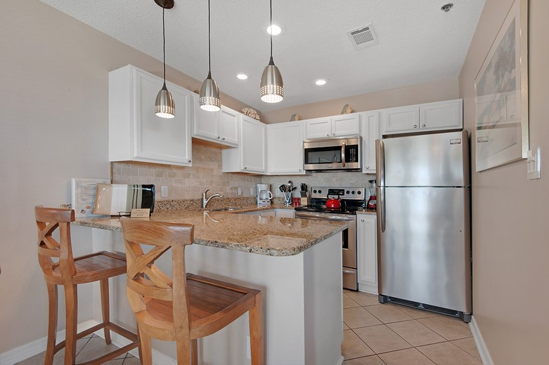 Well appointed kitchen with granite countertops and stainless steel appliances