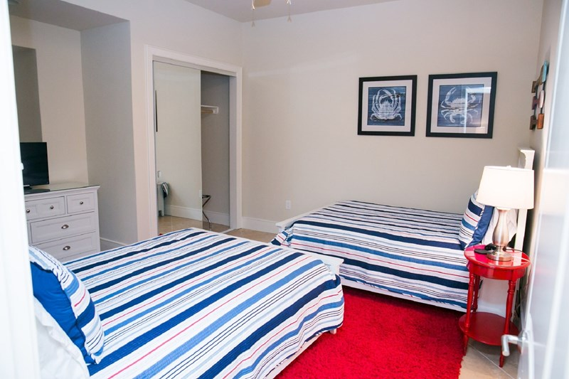 Nautical guest room w/ 2 double beds. Beautyrest mattresses
