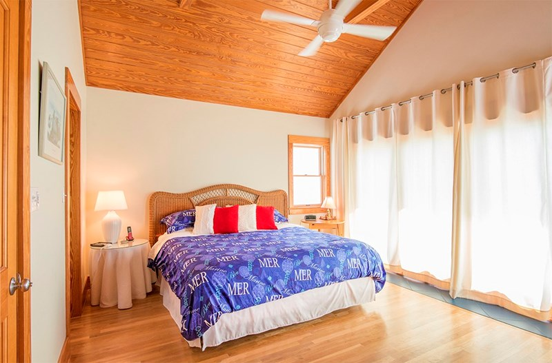Master bedroom w/super comfy king bed, cosy comforter, plush pillows. Immaculate & peaceful! Deck off bedroom w/gulf views.