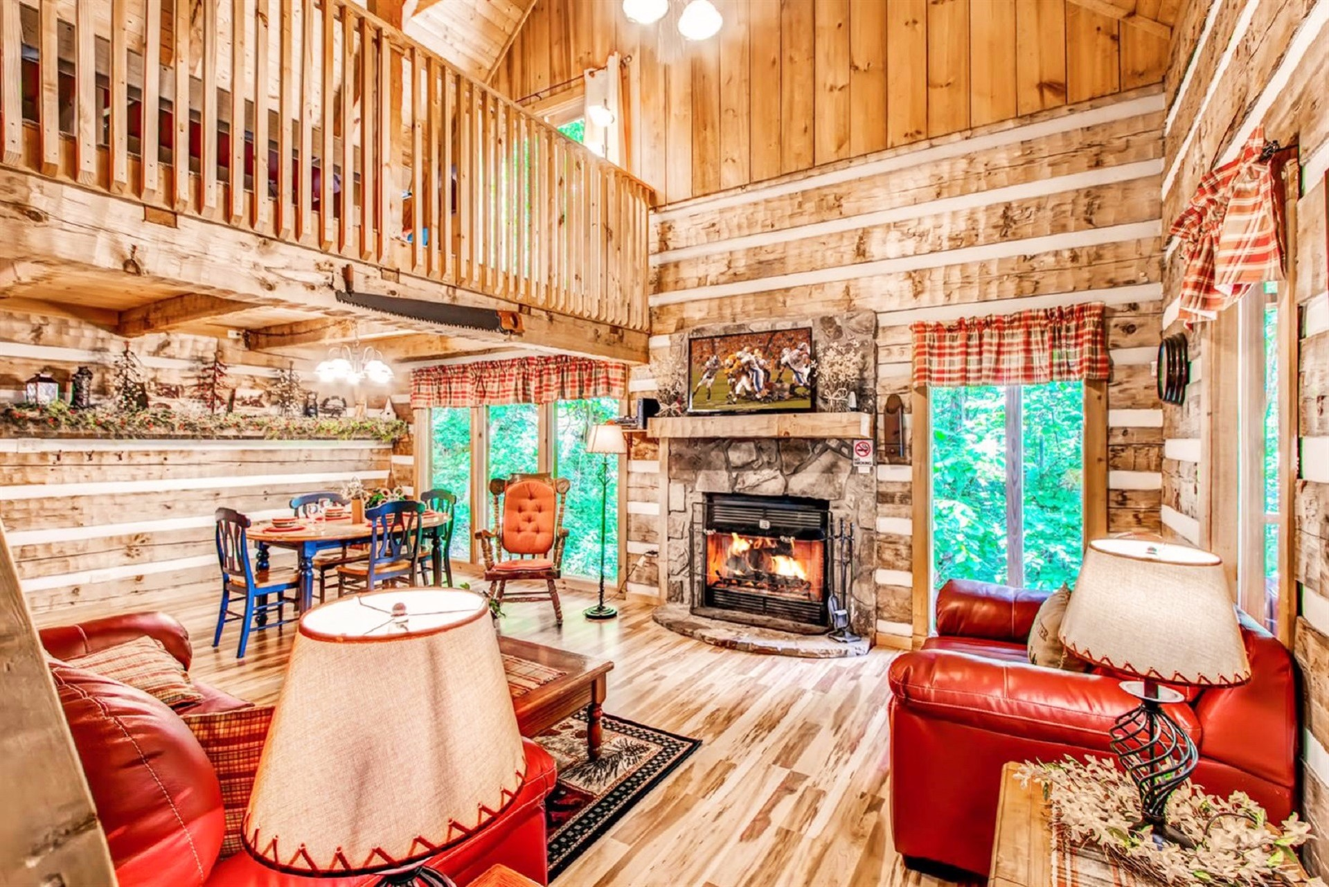 Living Area Features Wood Burning Fireplace, Large Window, Open To The Upper Level