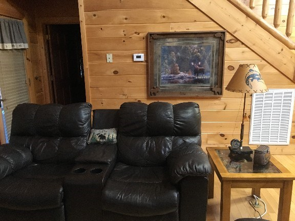 Great room has leather sofa and love seat with 4 recliners