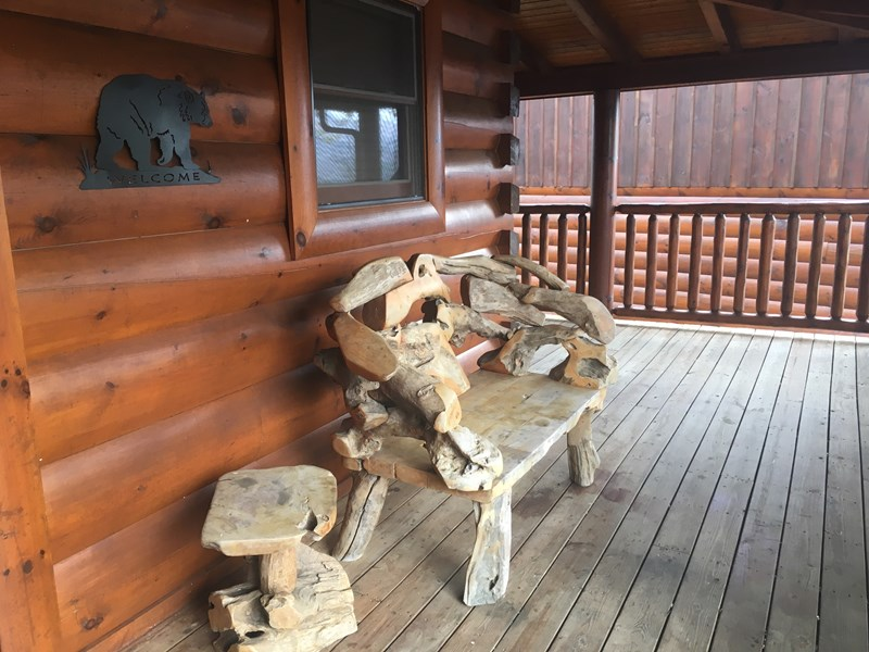 unique wood bench on front porch
