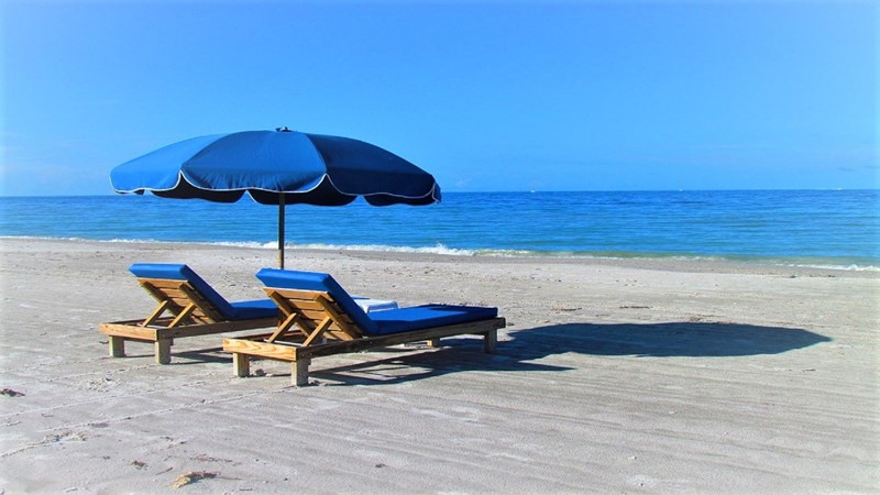 Seasonal Beach Chairs and Umbrella Provided Free as a Part of the Condo Rental
