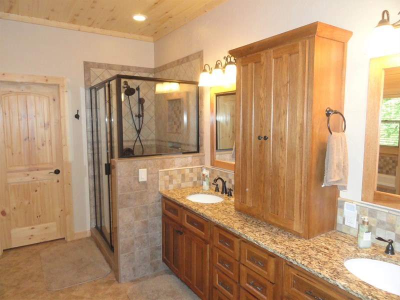 Main level - Modern, roomy, master bath with jacuzzi tub and walk in closet