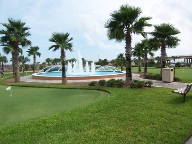 Caribe Fountain and natural turf putting green