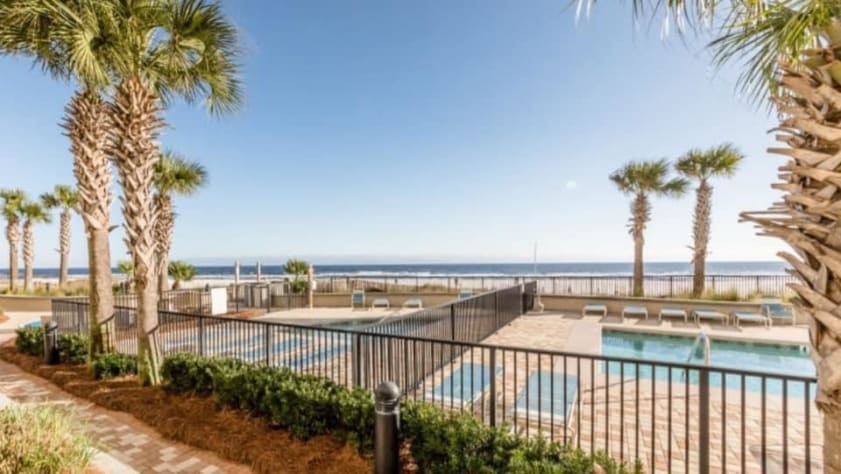 Walk right off patio to see two beautiful pools and the sand!