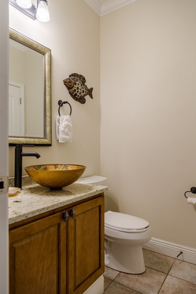 Convenient first floor half bath with designer vessel sink