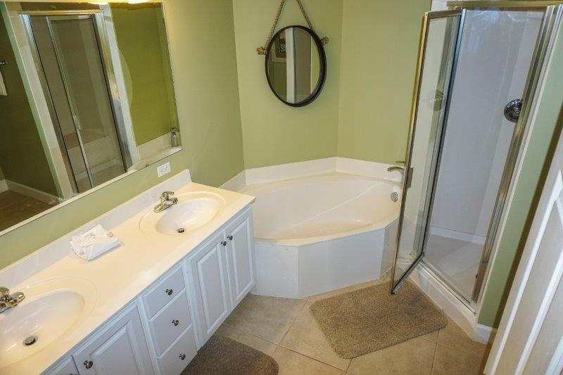 Master bath with double sinks, garden tub, and spacious shower