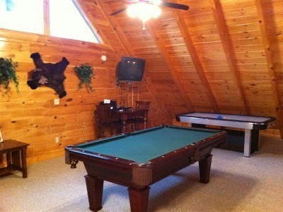 Loft has pool table & air hockey