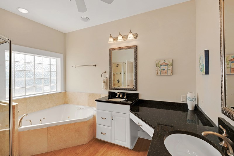Master bath with granite counters, jetted tub and separate walk in shower