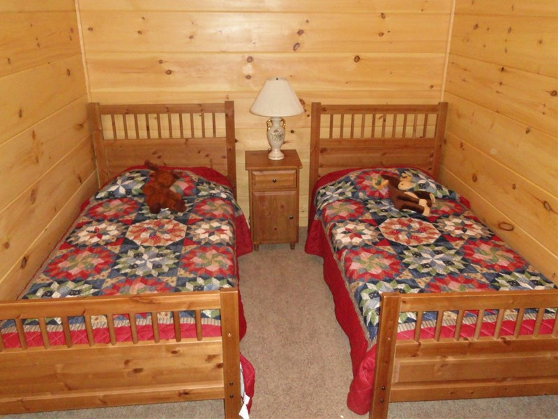Lower level - Bedroom #5 with two twin beds, shares full bath with Bedroom #4
