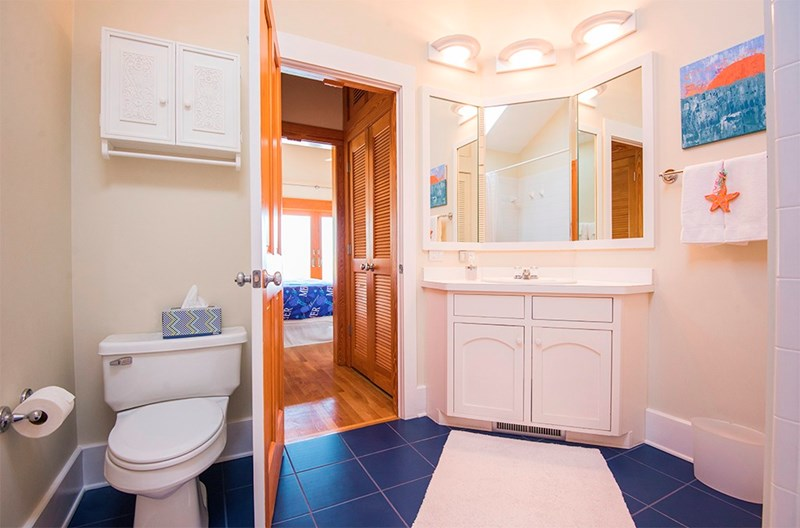 Crisp, bright & clean ensuite master bathroom. Tub/shower in this bathroom. Toto commode, lots of closet storage.