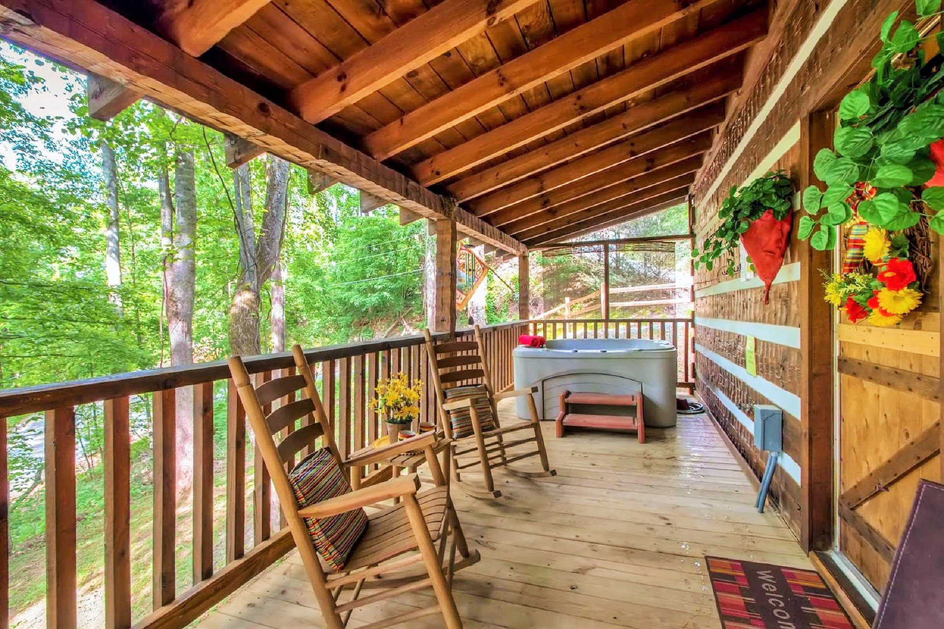 Covered Porch Features rocking chairs, porch swing and a new hot tub