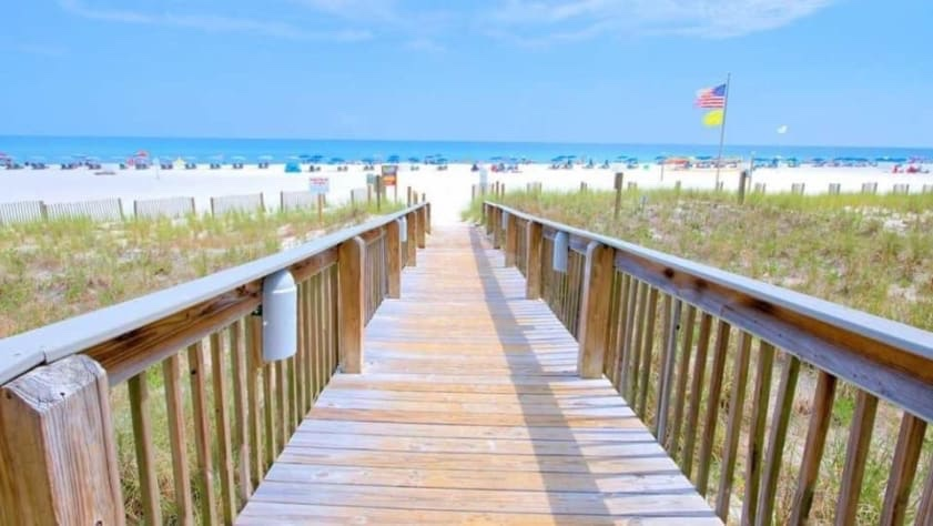 Just a few steps off our patio is a beautiful boardwalk down to the beach!