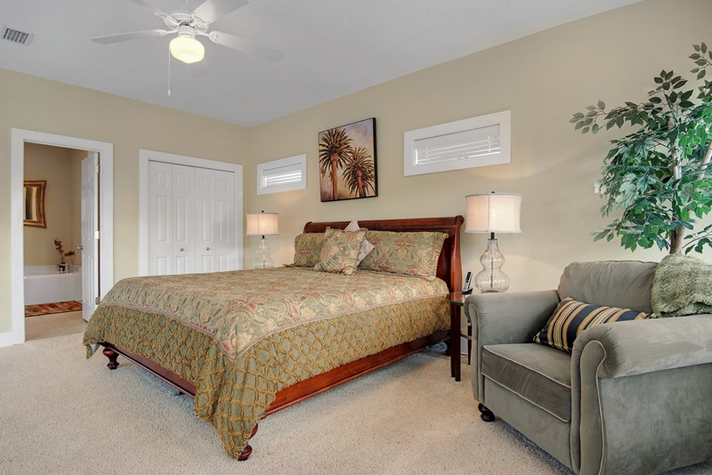 Master bedroom has king bed, sitting area and access to balcony