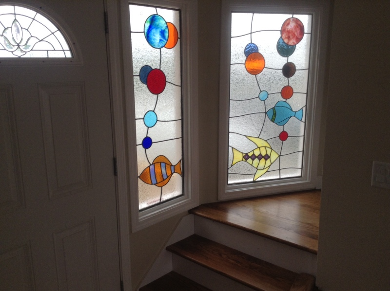 Front door/stain glass as u wind upstairs