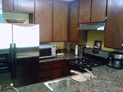 Closeup of Kitchen. Brand new stainless steel appliances...