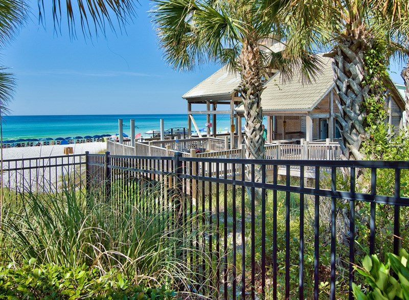Privated, gated beachside pavilion with private bathrooms, outdoor showers and cabana cafe!