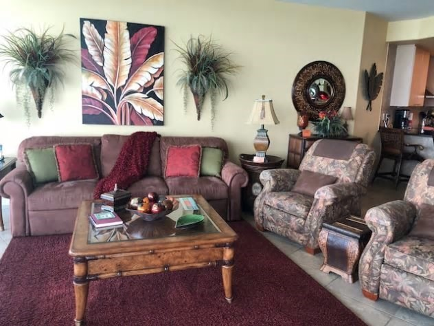 Living area with 2 recliners and a king size sofa sleeper