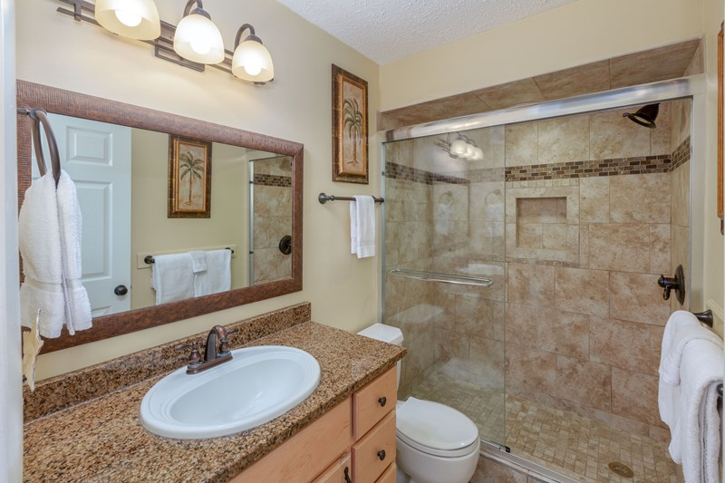 Master bath with walk-in shower and granite vanity