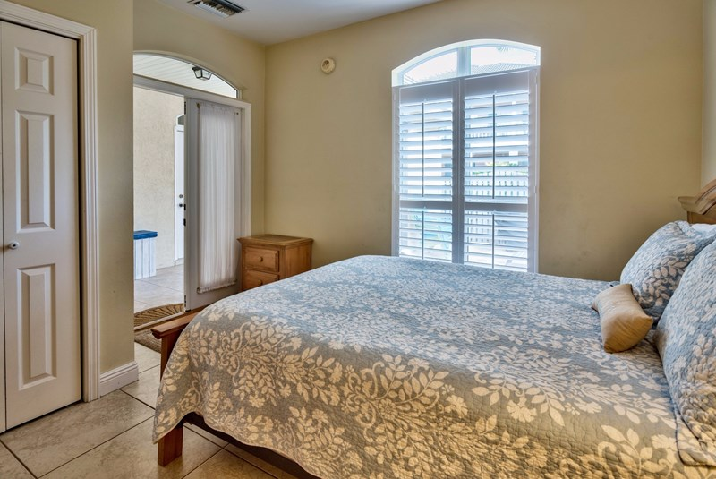 Queen bedroom with access to porch