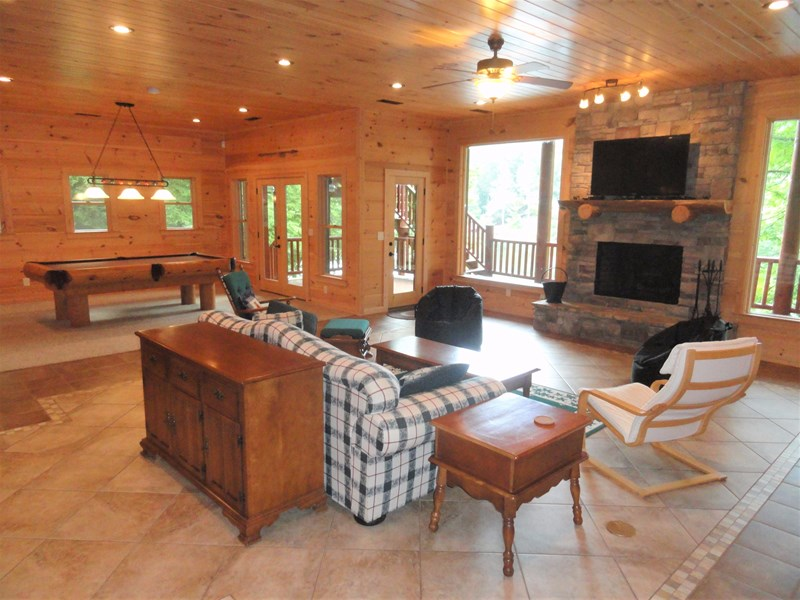 Lower level - Great room with living area, pool table, TV, and fireplace