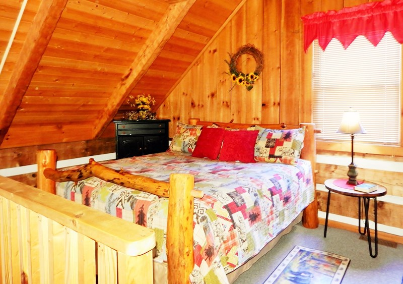 Loft Area (Open To Lower Level) Features A King Bed With New Bedding & Rustic Decor