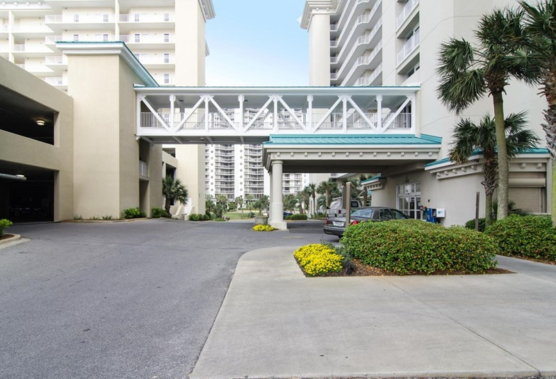 Garage parking with covered walkway to condos!