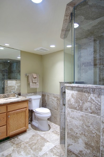 full bath marble floors, counters, glass shower