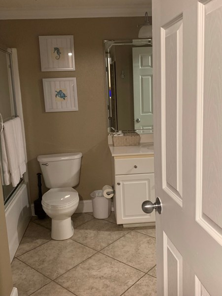Large shared bath with 3rd king and smaller twin bed room