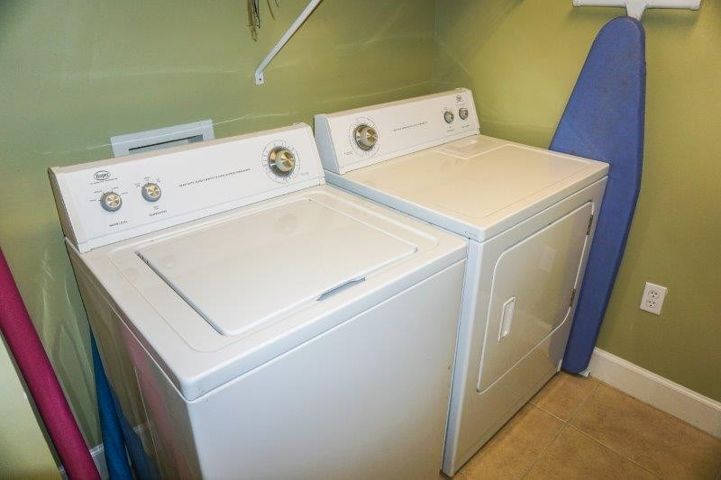 Full size washer/dryer in separate room