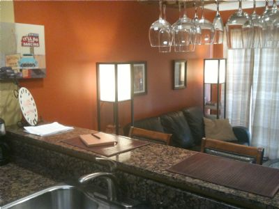 Bar/Kitchen area. Beautiful crystal stemware, granite counters. Flat Screen and Hearth Also Viewable