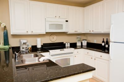 Kitchen with granite countertop and well-equipped for your stay!